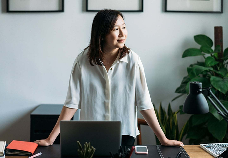 Asian woman at desk