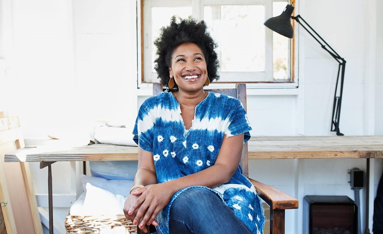 Black woman sitting in desk chair