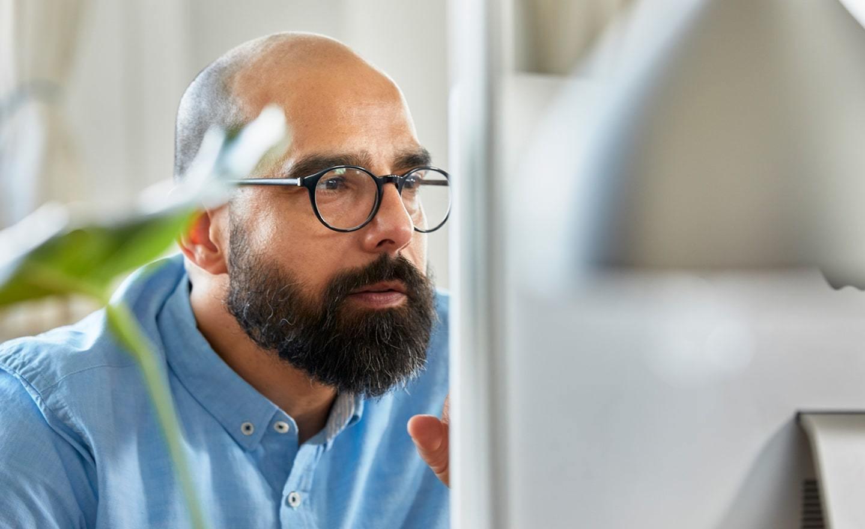Focused man working on computer