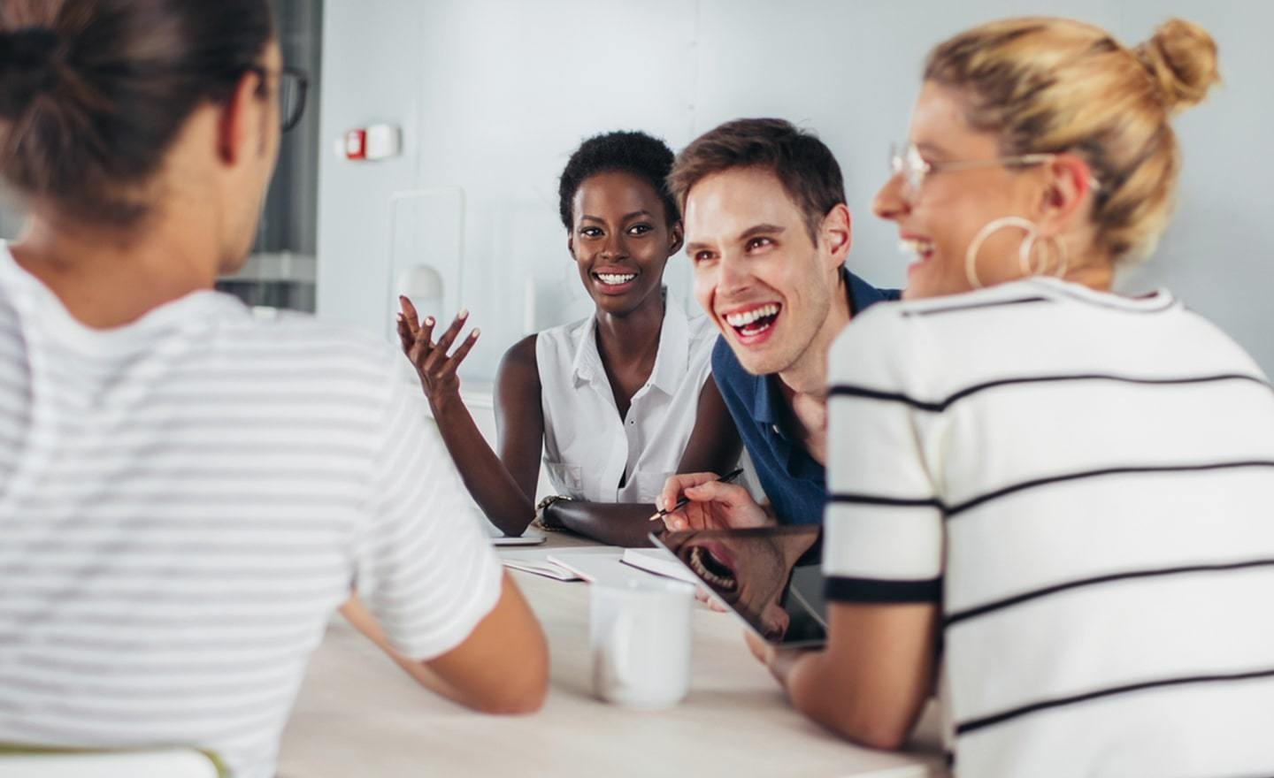 Group of laughing people at a conference table