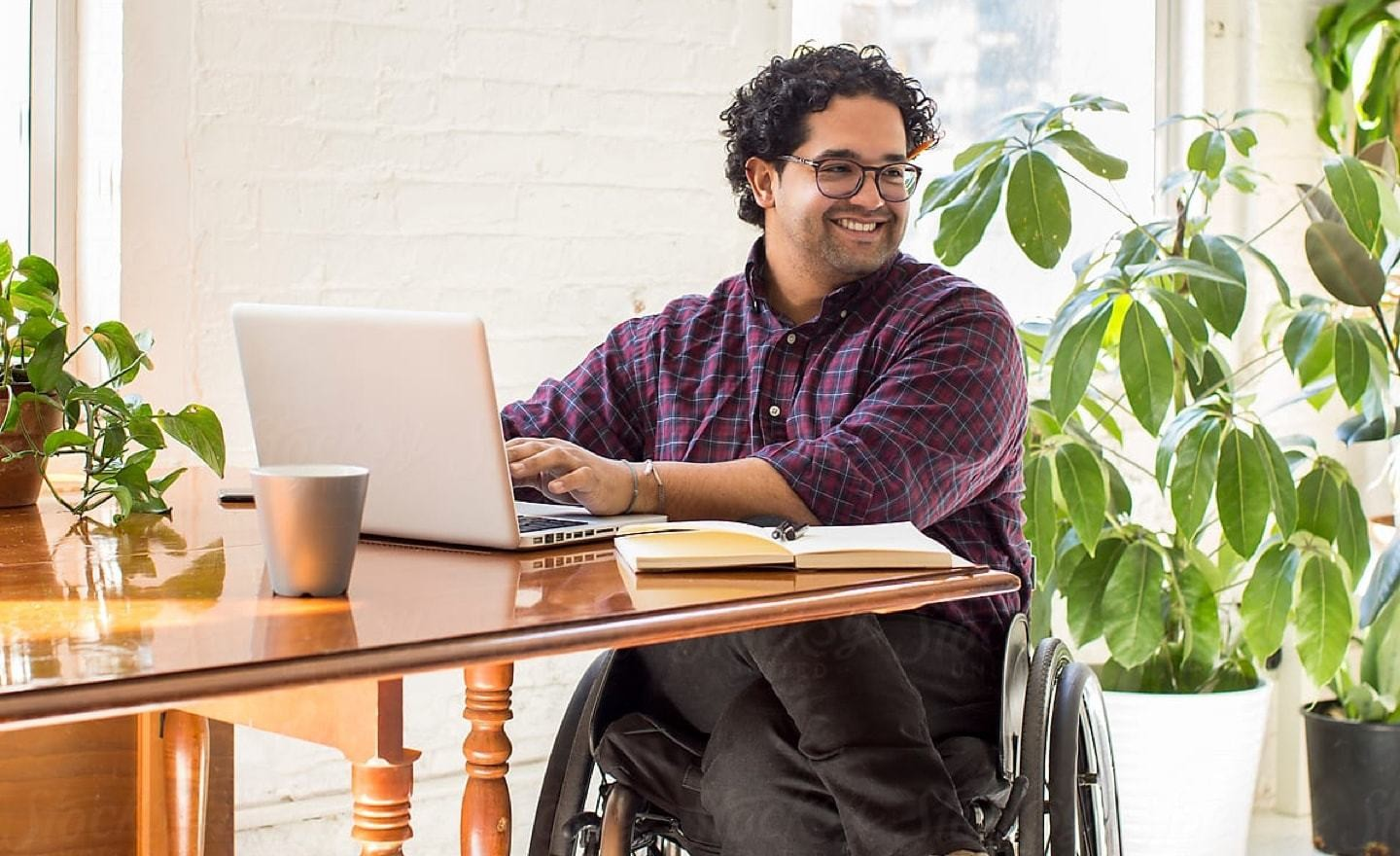 Man in wheelchair at table looking right