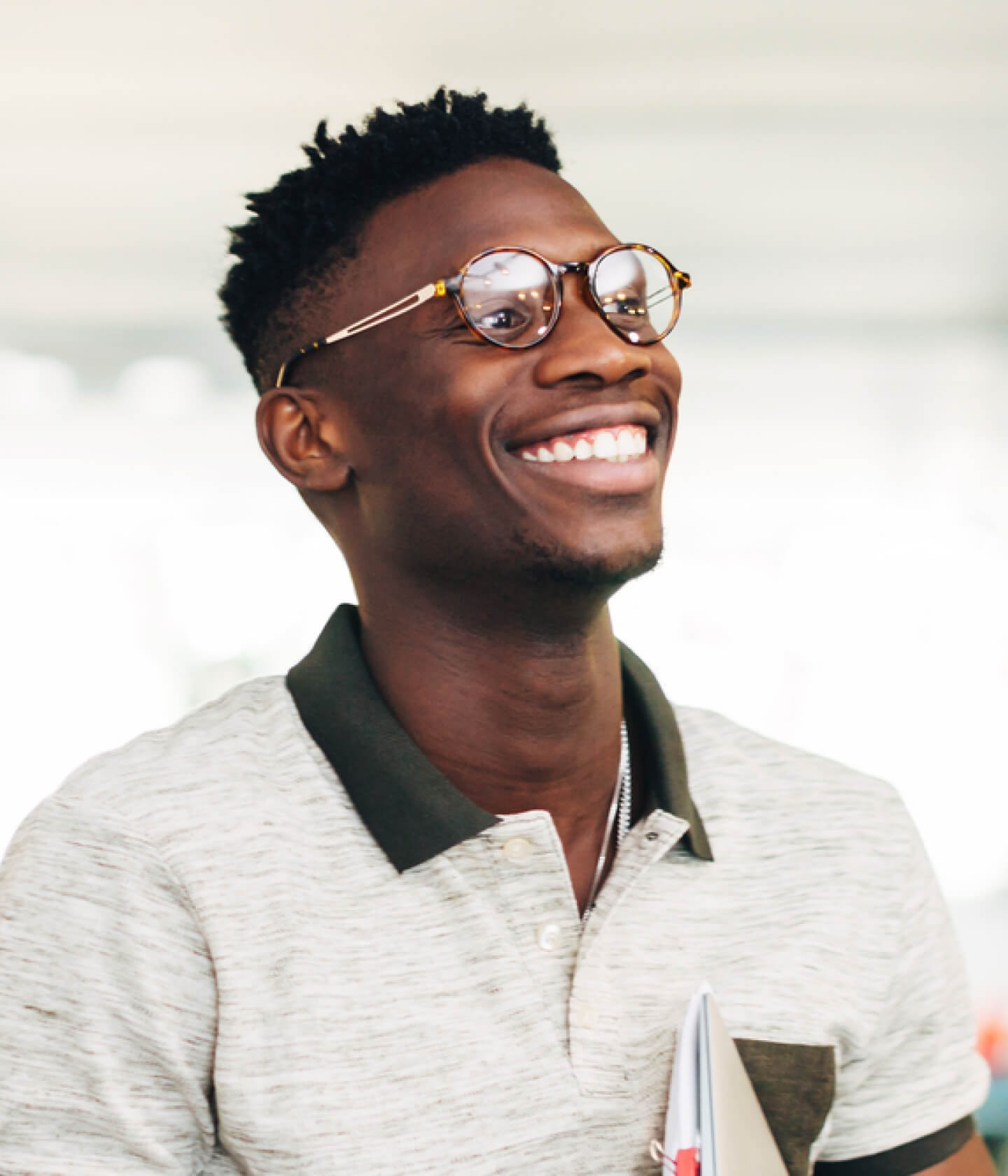 Photo of a young Black man with a big smile
