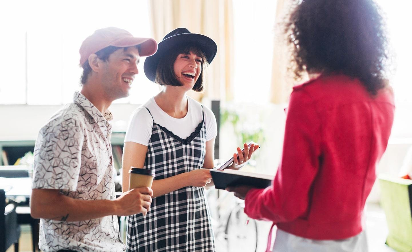Three people having a conversation while standing