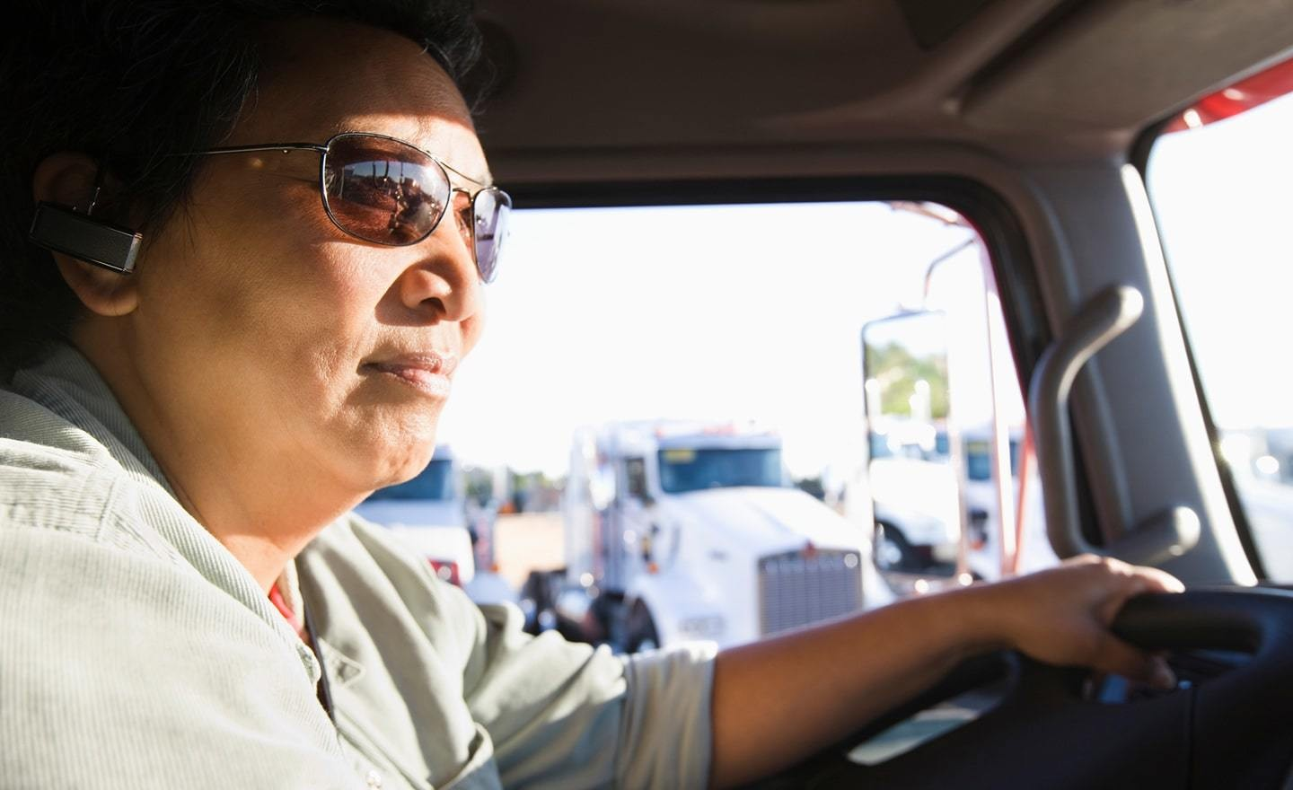 Truck driver seen in cab of truck