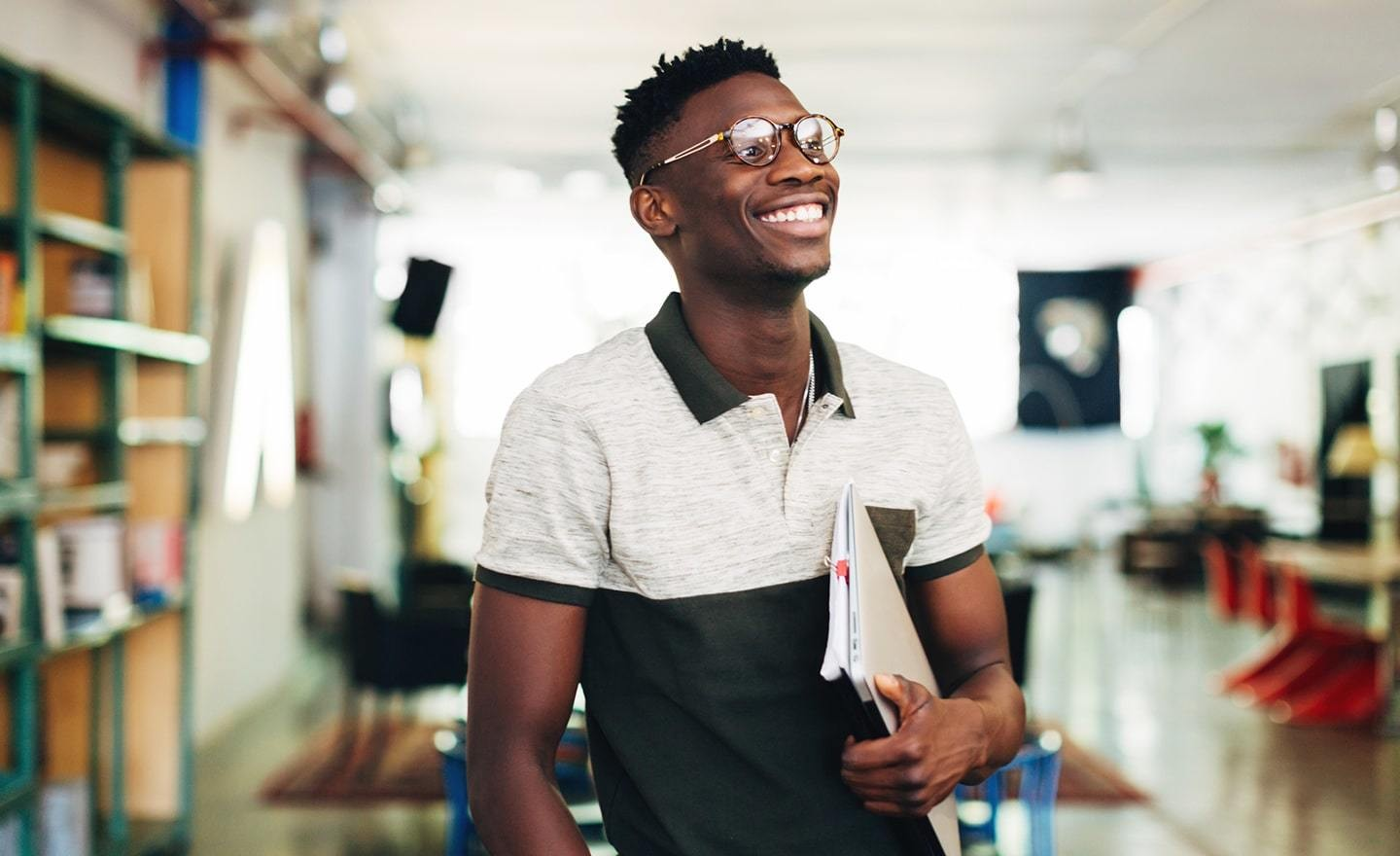 Young black man holding a notebook