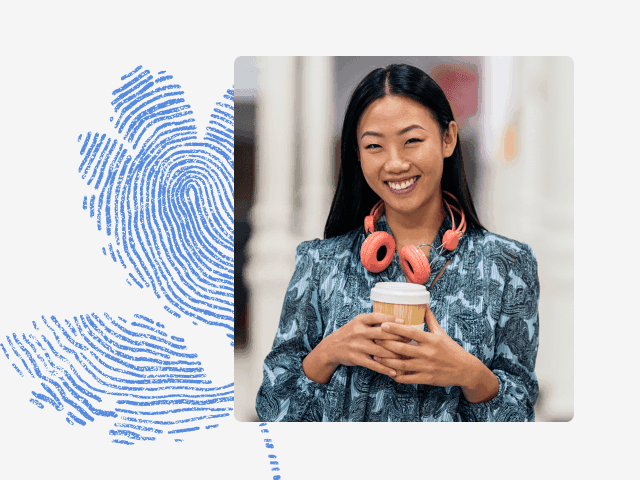 Photo of an Asian woman holding a coffee cup