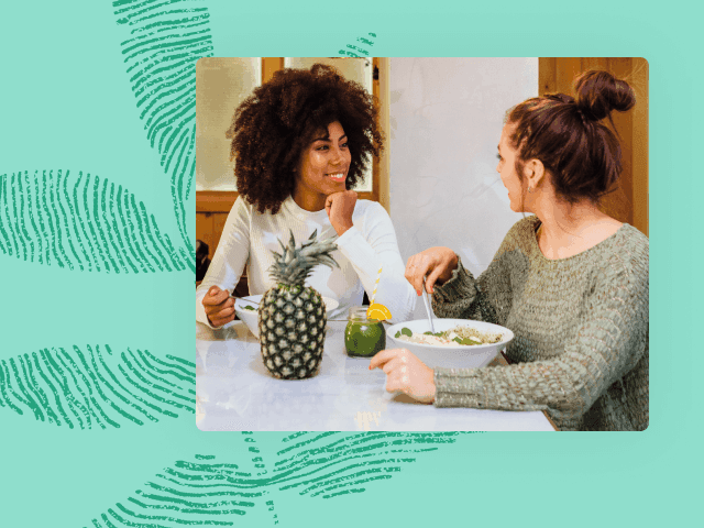 Photo of two women eating lunch