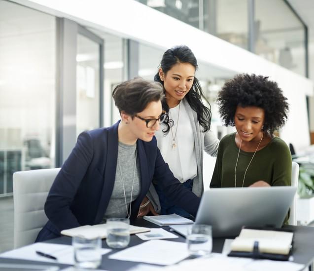 Photo of three Black women working together