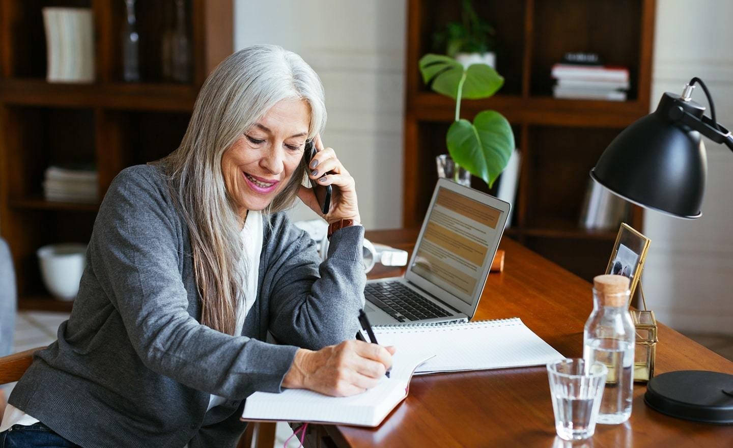 Older professional woman working from home