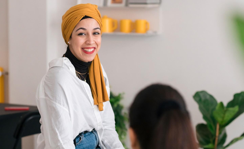 Photo of a woman wearing a yellow headdress
