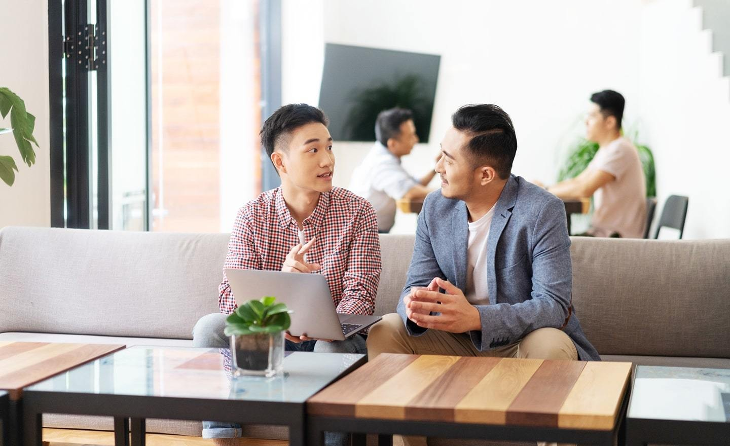 Two Asian men sitting at a table