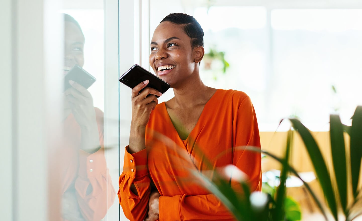 Woman doing phone interview in office
