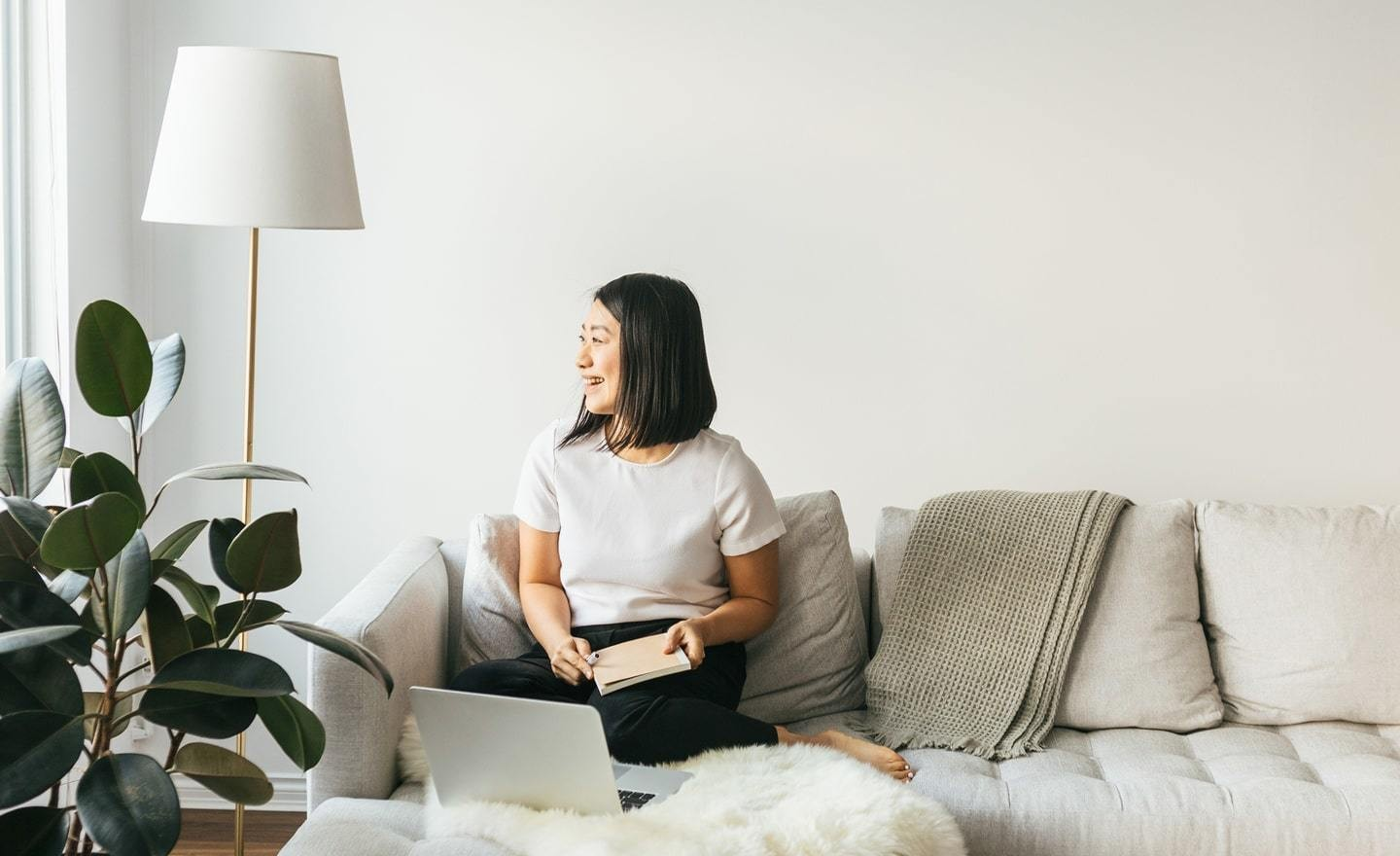 Woman working from living room 1