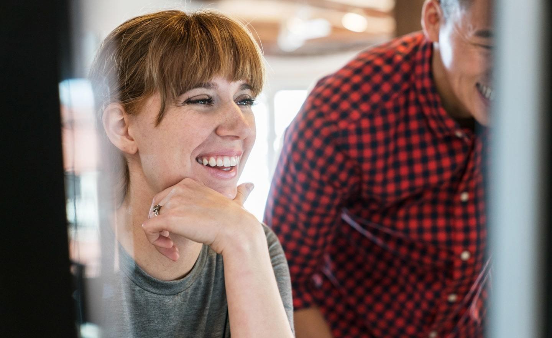 Smiling woman at computer