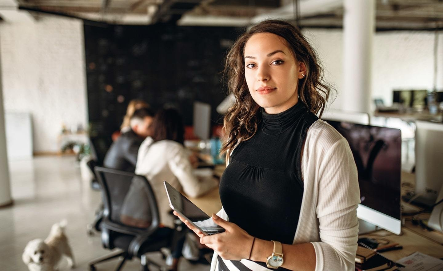 Woman in office holding iPad
