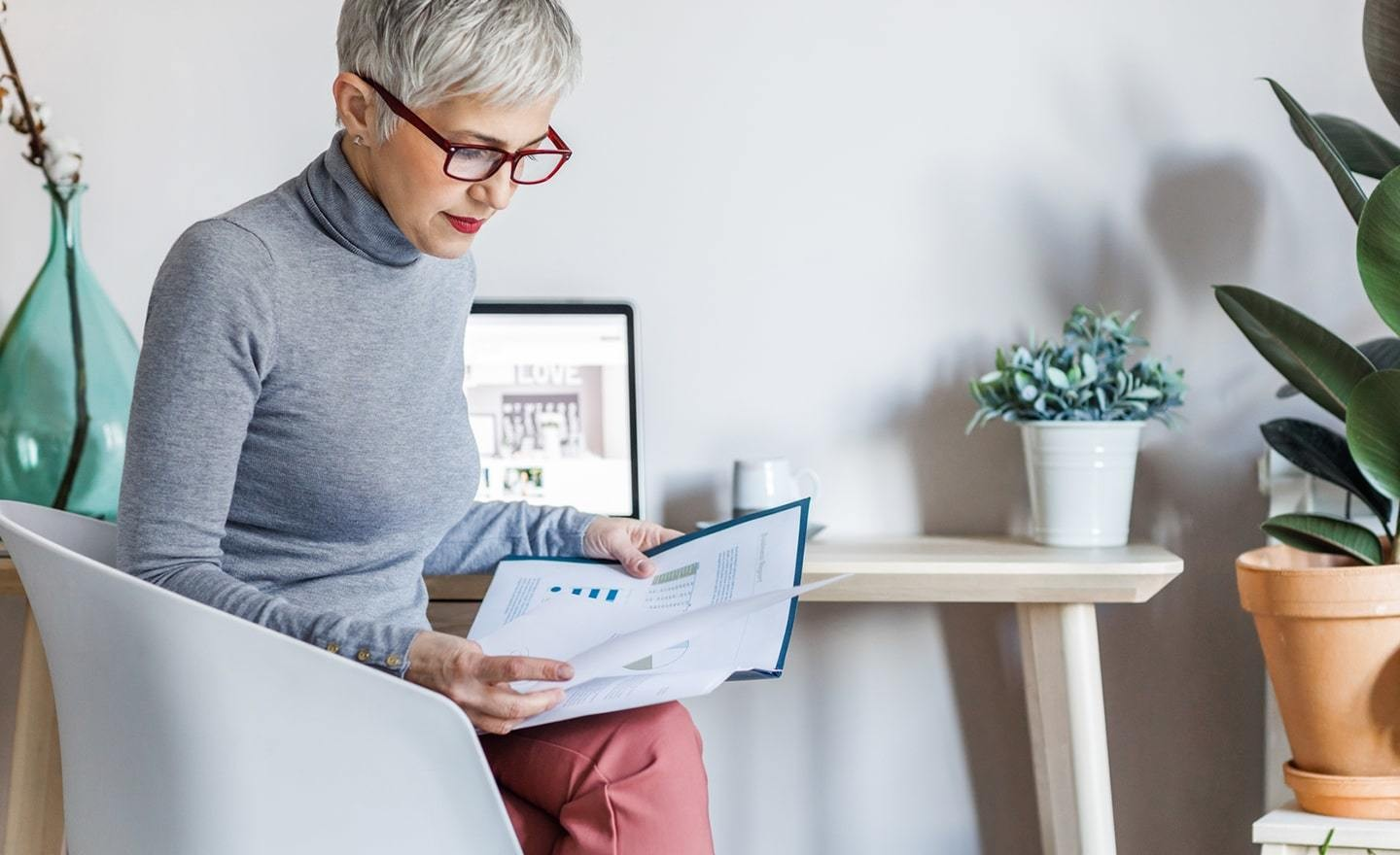 Woman sitting in chair reviewing document